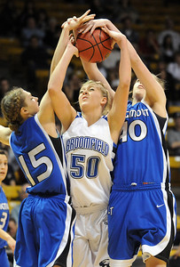 Broomfield's Bre Burgesser fights for the ball with Longmont's Tambre Haddock and Megan Carpenter during the class 4A championship game at the Coors Events Center in Boulder on Friday.   March 10, 2010 Staff photo/David R. Jennings