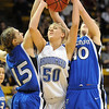 Broomfield's Bre Burgesser fights for the ball with Longmont's Tambre Haddock and Megan Carpenter during the class 4A championship game at the Coors Events Center in Boulder on Friday.<br /> <br /> <br /> March 10, 2010<br /> Staff photo/David R. Jennings