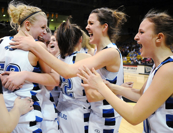 Broomfield's Bre Brugesser, left, Brittney Zec, Katie Nehf and  Taylor Schreter celebrate their victory over Longmont 55 - 47 to win their 4th straight  class 4A championship  at the Coors Events Center in Boulder on Friday.<br /> <br /> <br /> <br /> March 10, 2010<br /> Staff photo/David R. Jennings