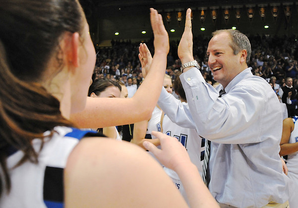Broomfield's head coach Mike Croell gives high fives to his team after winning their 4th straight class 4A championship at the Coors Events Center in Boulder on Friday.<br /> <br /> <br /> March 12, 2010<br /> Staff photo/David R. Jennings