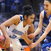 Broomfield'sTyana Medema moves the ball away from Longmont's  during the class 4A championship game at the Coors Events Center in Boulder on Friday.<br /> <br /> <br /> March 12, 2010<br /> Staff photo/David R. Jennings