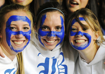 Broomfield fans Elizabeth Belton, left, Emma Leenerman and Lindsay Dye painted their faces in blue  BHS letters for the  class 4A championship game against Longmont at the Coors Events Center in Boulder on Friday.   March 12, 2010 Staff photo/David R. Jennings