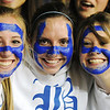 Broomfield fans Elizabeth Belton, left, Emma Leenerman and Lindsay Dye painted their faces in blue  BHS letters for the  class 4A championship game against Longmont at the Coors Events Center in Boulder on Friday.<br /> <br /> <br /> March 12, 2010<br /> Staff photo/David R. Jennings