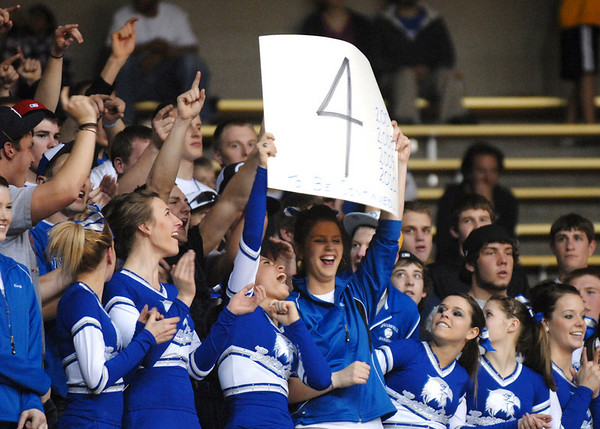 Broomfield's pom squad holds up a sign for the 4-peat of the   girls team for the class 4A championship at the Coors Events Center in Boulder on Friday.<br /> <br /> <br /> March 12, 2010<br /> Staff photo/David R. Jennings
