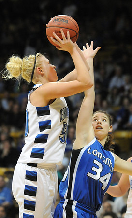 Broomfield's Bre Burgesser fights to get to the basket against Longmont's Jill Van Thuyne during the class 4A championship game at the Coors Events Center in Boulder on Friday.<br /> <br /> <br /> March 12, 2010<br /> Staff photo/David R. Jennings