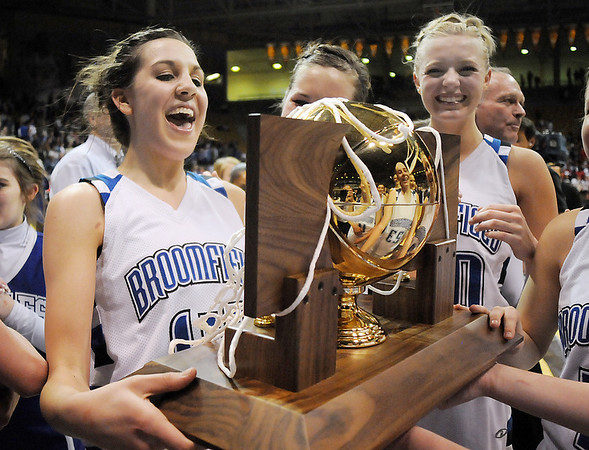 Katie Nehf  cheers while holding Broomfield's 4th state championship trophy after defeating Longmont 55 to 47 in the class 4A championship game at the Coors Events Center in Boulder on Friday.<br /> <br /> <br /> March 10, 2010<br /> Staff photo/David R. Jennings