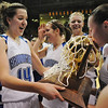 Katie Nehf, left, looking and holding Broomfield's 4th state championship trophy, is all smiles as Sarah Hix kisses the trophy after the Eagles defeated Longmont 55 to 47 for the class 4A championship at the Coors Events Center in Boulder on Friday.<br /> <br /> <br /> March 12, 2010<br /> Staff photo/David R. Jennings