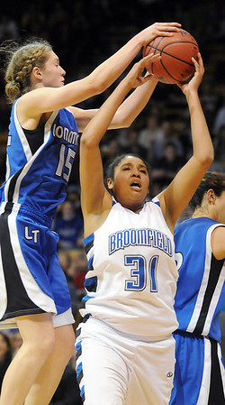 Broomfield's Tyana Medema tries to get to the basket against Longmont's Megan Carpenter during the class 4A championship game at the Coors Events Center in Boulder on Friday.<br /> <br /> <br /> March 10, 2010<br /> Staff photo/David R. Jennings