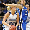 Broomfield's Bre Burgesser fights to get to the basket against Longmont's Jill Van Thuyne during the class 4A championship game at the Coors Events Center in Boulder on Friday.<br /> <br /> <br /> March 10, 2010<br /> Staff photo/David R. Jennings