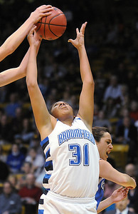 Broomfield's Tyana Medema rebounds the ball from Longmont during the class 4A championship game at the Coors Events Center in Boulder on Friday.   March 12, 2010 Staff photo/David R. Jennings