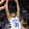 Broomfield's Tyana Medema rebounds the ball from Longmont during the class 4A championship game at the Coors Events Center in Boulder on Friday.<br /> <br /> <br /> March 12, 2010<br /> Staff photo/David R. Jennings