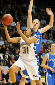Broomfield's Tyana Medema drives to the basket past Longmont's Megan Carpenter during the class 4A championship game at the Coors Events Center in Boulder on Friday.   March 10, 2010 Staff photo/David R. Jennings