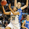 Broomfield's Tyana Medema drives to the basket past Longmont's Megan Carpenter during the class 4A championship game at the Coors Events Center in Boulder on Friday.<br /> <br /> <br /> March 10, 2010<br /> Staff photo/David R. Jennings
