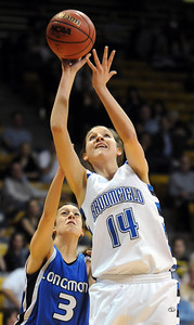 Broomfield's Katie Nehf shoots past Longmont's Jordan Arguello during the class 4A championship game at the Coors Events Center in Boulder on Friday.   March 10, 2010 Staff photo/David R. Jennings