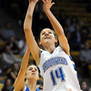 Broomfield's Katie Nehf shoots past Longmont's Jordan Arguello during the class 4A championship game at the Coors Events Center in Boulder on Friday.<br /> <br /> <br /> March 10, 2010<br /> Staff photo/David R. Jennings