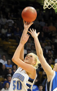 Broomfield's Bre Burgesser goes to the basket against Longmont during the class 4A championship game at the Coors Events Center in Boulder on Friday.   March 10, 2010 Staff photo/David R. Jennings