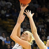 Broomfield's Bre Burgesser goes to the basket against Longmont during the class 4A championship game at the Coors Events Center in Boulder on Friday.<br /> <br /> <br /> March 10, 2010<br /> Staff photo/David R. Jennings