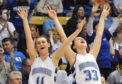 Broomfield's Kody Bradfield, left, and Millie Reeves cheer as the Eagles win their 4th straight championship against  Longmontin the class 4A championship game at the Coors Events Center in Boulder on Friday.   March 10, 2010 Staff photo/David R. Jennings