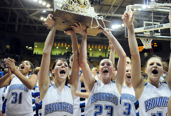 Tyana Medema, left, Autumn Chase Sarah Hix cheer while holding Broomfield's 4th state championship trophy after defeating Longmont 55 to 47 in the class 4A championship game at the Coors Events Center in Boulder on Friday.<br /> <br /> <br /> March 10, 2010<br /> Staff photo/David R. Jennings