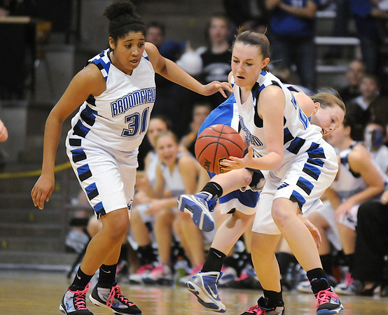 Broomfield's Sarah Hix, right, and Tyana Medema steal the ball from Longmont during the class 4A championship game at the Coors Events Center in Boulder on Friday.<br /> <br /> <br /> March 12, 2010<br /> Staff photo/David R. Jennings