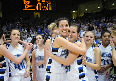 Katie Nehf, center left, hugs Millie Reeves after Broomfield's victory over Longmont to win their 4th straight  the class 4A championship at the Coors Events Center in Boulder on Friday.   March 10, 2010 Staff photo/David R. Jennings