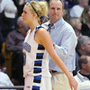 Bre Burgesser is comforted by coach Mike Croell after fouling out of the game against Longmont's for the class 4A championship at the Coors Events Center in Boulder on Friday.<br /> <br /> <br /> March 12, 2010<br /> Staff photo/David R. Jennings