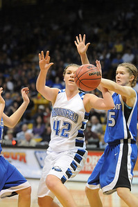 Broomfield's Renae Waters fights for the ball with Longmont's Hanah Carney during the class 4A championship game at the Coors Events Center in Boulder on Friday.   March 10, 2010 Staff photo/David R. Jennings