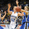 Broomfield's Renae Waters fights for the ball with Longmont's Hanah Carney during the class 4A championship game at the Coors Events Center in Boulder on Friday.<br /> <br /> <br /> March 10, 2010<br /> Staff photo/David R. Jennings