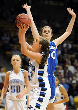 Broomfield's Renae Waters goes to the basket against Longmont's Megan Carpenter during the class 4A championship game at the Coors Events Center in Boulder on Friday.<br /> <br /> <br /> March 10, 2010<br /> Staff photo/David R. Jennings