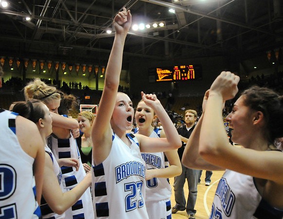 Broomfield's Sarah Hix leads the team in a cheer after winning their 4th class 4A championship by defeating Longmont at the Coors Events Center in Boulder on Friday.<br /> <br /> <br /> March 12, 2010<br /> Staff photo/David R. Jennings
