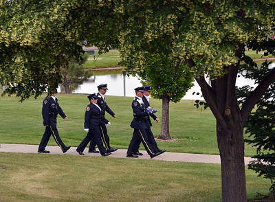 The combined North Metro Fire and Broomfield Police Honor Guard march the flag from the 9/11 Memorial for Thursday's 8th Annual Flag Retirement Ceremony at the Community Park Amphitheater.  June 14, 2012  staff photo/ David R. Jennings