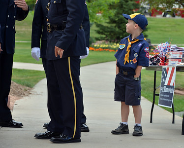 Cub Scout Charlie Burke, 6, watches the combined honor guard prepares for Thursday's 8th Annual Flag Retirement Ceremony at the Community Park Amphitheater.  June 14, 2012  staff photo/ David R. Jennings