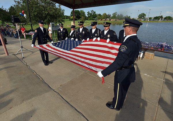 The combined Broomfield Police and North Metro Fire Rescue Honor Guard present the 9/11 Memorial flag for retirement during Thursday's 8th Annual Flag Retirement Ceremony at the Community Park Amphitheater.<br /> <br /> June 14, 2012 <br /> staff photo/ David R. Jennings