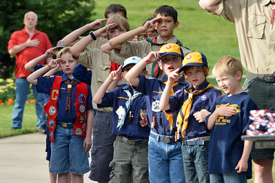 Boy Scouts and Cub Scouts salute as the 9/11 Memorial falg is presented for retirement during Thursday's 8th Annual Flag Retirement Ceremony at the Community Park Amphitheater.  June 14, 2012  staff photo/ David R. Jennings