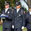Broomfield Police Officer Todd Dahlbach, left, and North Metro Fire Rescue Engineer Ken Work lead the combined honor guard with the folded the 9/11 Memorial flag for retirement during Thursday's 8th Annual Flag Retirement Ceremony at the Community Park Amphitheater.<br /> <br /> June 14, 2012 <br /> staff photo/ David R. Jennings