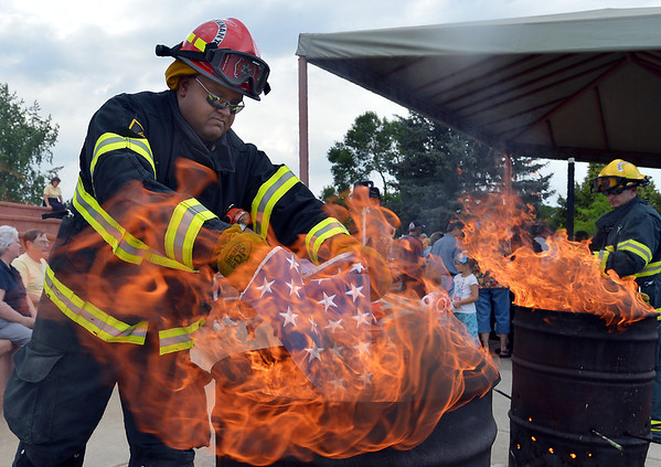 North Metro Fire Rescue Lt. Brian MIlls places a field of stars in the fire during Thursday's 8th Annual Flag Retirement Ceremony at the Community Park Amphitheater.<br /> <br /> <br /> June 14, 2012 <br /> staff photo/ David R. Jennings