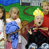 "BE0627APLAY08.jpg BE0627APLAY08<br /> The emperor Ryan Montera sings while waiting for his new cloths with the emperor's assistant, Yuri Eckelkam, right, Charlize Ruybal, left, and Sofia Hermann during Broomfield Academy Summer Camp's play ""The Emperor's News Clothes"" on Friday.<br /> <br /> June 18, 2010<br /> Staff photo/ David R. Jennings"