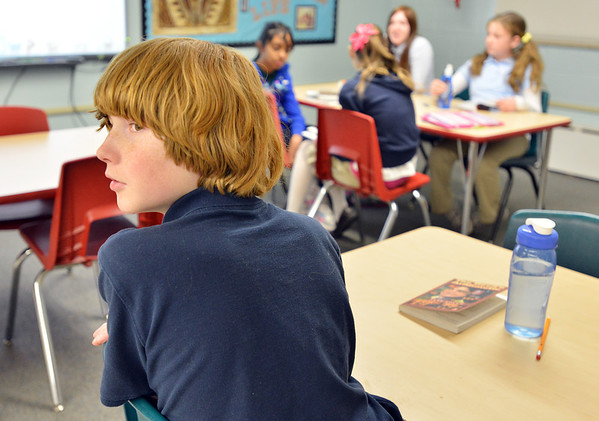 "Graham Hoyle answers questions during 7th grade literature class studying the book ""The Devil's Arithmetic"" at the Broomfield Academy on Thursday.<br /> January 10, 2013<br /> staff photo/ David R. Jennings"