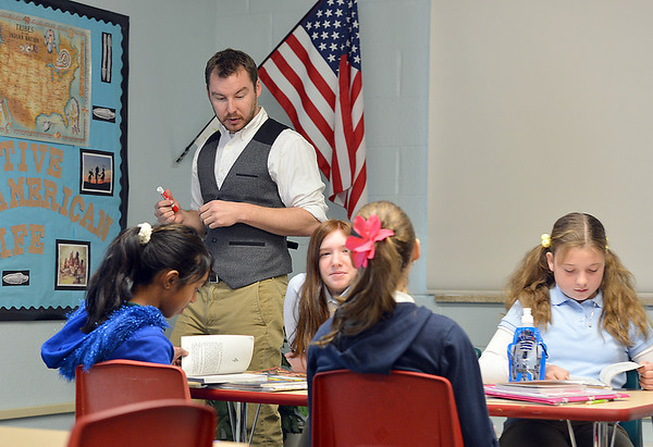 "Davis Turner teaches the 7th grade literature class studying the book ""The Devil's Arithmetic"" at the Broomfield Academy on Thursday.<br /> January 10, 2013<br /> staff photo/ David R. Jennings"