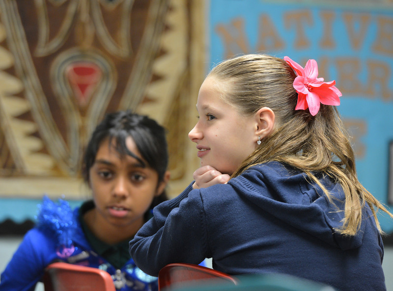"Sydney Wagner, right, and Sneha Varanasi answers questions during 7th grade literature class studying the book ""The Devil's Arithmetic"" at the Broomfield Academy on Thursday.<br /> January 10, 2013<br /> staff photo/ David R. Jennings"