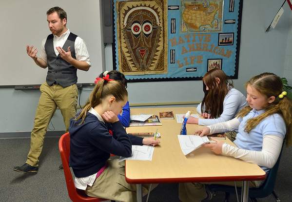 "Davis Turner, left, teaches the 7th grade literature class studying the book ""The Devil's Arithmetic"" at the Broomfield Academy on Thursday.<br /> January 10, 2013<br /> staff photo/ David R. Jennings"