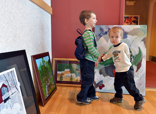 Tobias England, 6, with his brother David, 3, look at paintings by Broomfield Art Guild artists  during the hanging 38 art pieces from 25 artists in the lobby of the Audi on Friday.<br /> November 16, 2012<br /> staff photo/ David R. Jennings