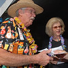Carl and Doris Sauerland came dressed for the Broomfield Community Foundation's 2009 Broomfield BASH at the Beach fundraiser held at Sill-TerHar Motors on Saturday.<br /> <br /> July 18, 2009<br /> staff photo/David Jennings