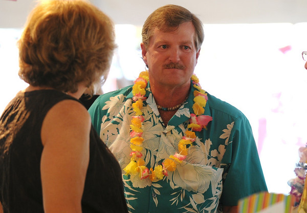 Councilman Randy Ahrens chats during the Broomfield Community Foundation's 2009 Broomfield BASH at the Beach fundraiser held at Sill-TerHar Motors on Saturday.<br /> <br /> July 18, 2009<br /> staff photo/David Jennings