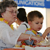 Diane Dunshee, left, with her grandson Ben Mackert, 4, during the Broomfield Community Foundation's 2009 Broomfield BASH at the Beach fundraiser held at Sill-TerHar Motors on Saturday.<br /> <br /> July 18, 2009<br /> staff photo/David Jennings