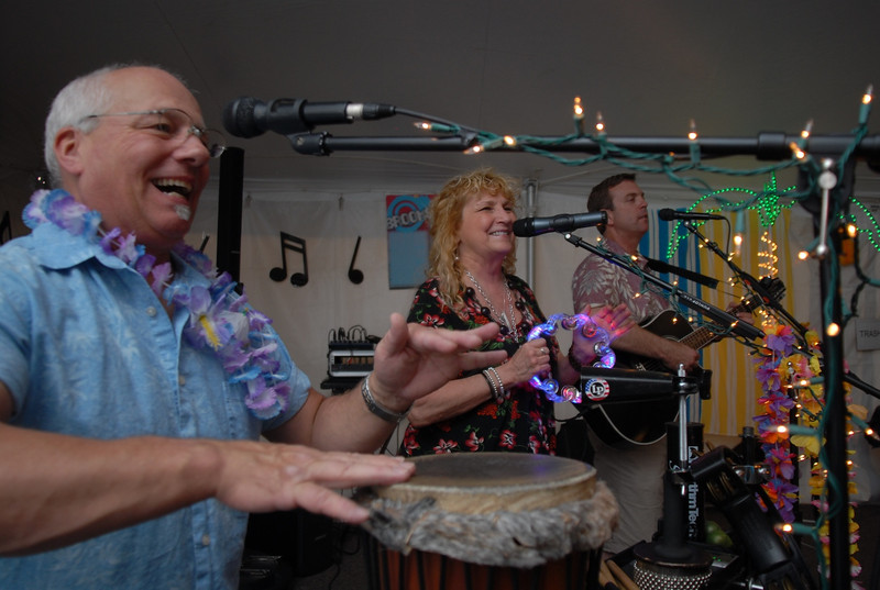 The music of Soho, Eric Wallace, left, Cindy Wallace and Mark Todd entertain participants during the Broomfield Community Foundation's 2009 Broomfield BASH at the Beach fundraiser held at Sill-TerHar Motors on Saturday.<br /> <br /> July 18, 2009<br /> staff photo/David Jennings