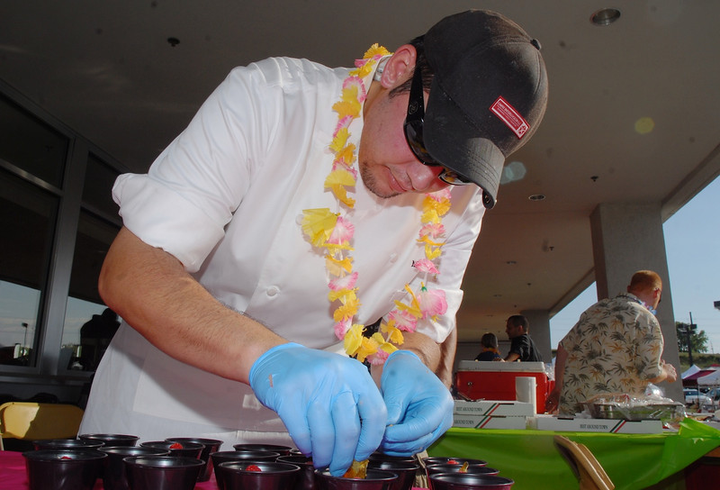 Chef Mario Clapes with the Meritage Restaurant at the Omni Hotel, prepares a fruit dish for participants at the Broomfield Community Foundation's 2009 Broomfield BASH at the Beach fundraiser held at Sill-TerHar Motors on Saturday.<br /> <br /> July 18, 2009<br /> staff photo/David Jennings