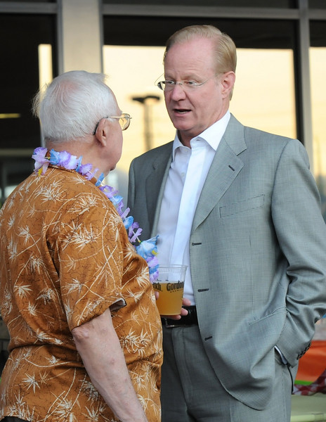 Bob Seeber, left, chats with Jack TerHar during the Broomfield Community Foundation's 2009 Broomfield BASH at the Beach fundraiser held at Sill-TerHar Motors on Saturday.<br /> <br /> July 18, 2009<br /> staff photo/David Jennings