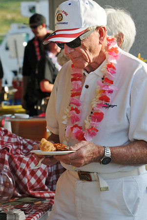 Dr. Bill Markel samples the food from restaurants during the Broomfield Community Foundation's 2009 Broomfield BASH at the Beach fundraiser held at Sill-TerHar Motors on Saturday.<br /> <br /> July 18, 2009<br /> staff photo/David Jennings