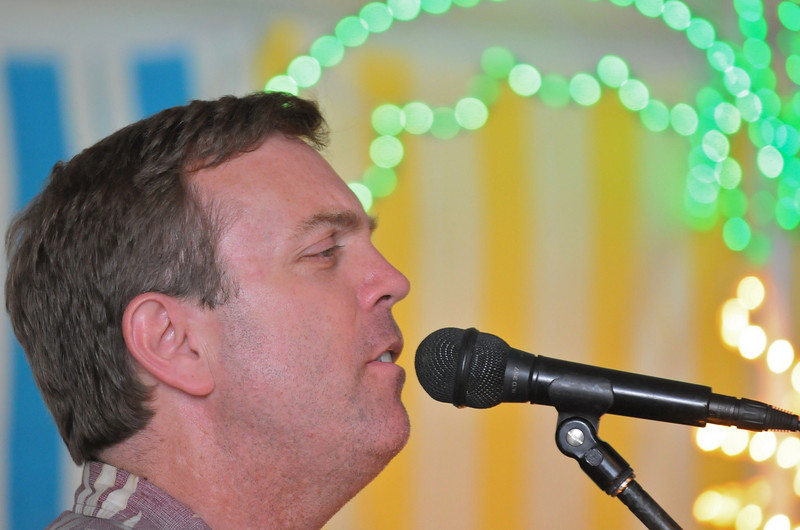 Mark Todd with SOHO entertains participants during the Broomfield Community Foundation's 2009 Broomfield BASH at the Beach fundraiser held at Sill-TerHar Motors on Saturday.<br /> <br /> July 18, 2009<br /> staff photo/David Jennings